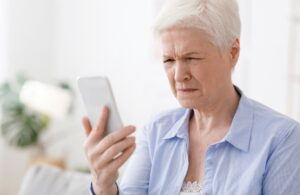 Elderly women having trouble focusing her vision